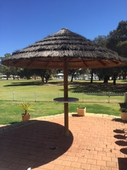 Umberellor  African Thatch with centre table